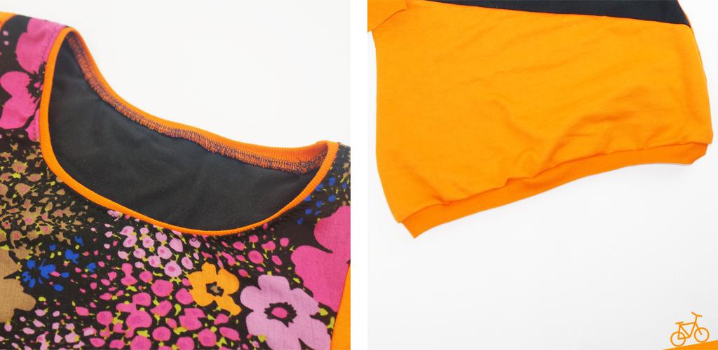 Hier siehst du einen Halsausschnitt mit orangefarbendem Bündchen und einen Bündchensaum.