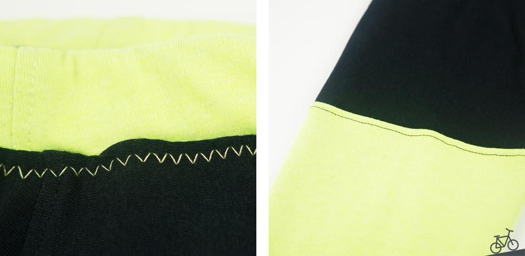 Schwarzer Stoff mit gelber Naht und gelber Stoff mit schwarzer Naht