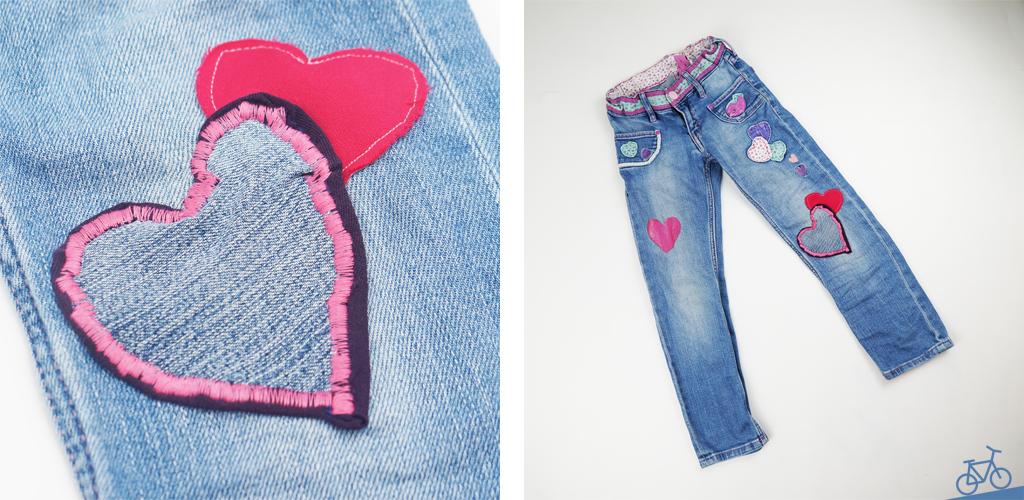 Jeans mit aufgenähten Herzen als Flicken