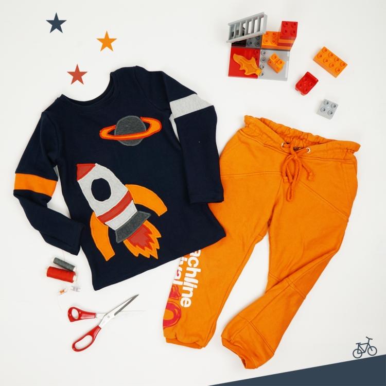 Upcycling Langarmshirt dunkelblau mit Applikation Rakete in hellgrau dunkelgrau orange und rot, Jogginghose